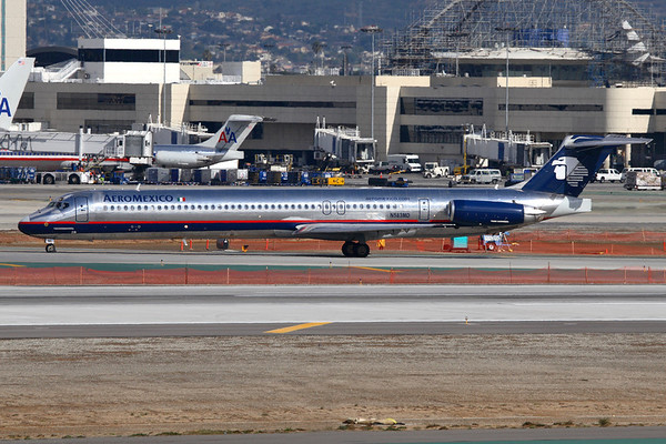 Reg: N583MD Operator:  AeroMexico Type:  McDonnell Douglas MD-83		   C/n: 49659 / 1438 Location:  Los Angeles - International (LAX / KLAX) - USA    Vacating runway 2.L at LAX and taxiing to the terminal - in the background work takes place on the iconicTheme Building. Taken from Clutter's Park on East Imperial Avenue to the South of the airport complex.     Photo Date:  22 January 2008 Photo ID: 1300583