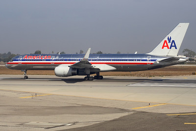 Reg: N689AA Operator:  American Airlines Type:  Boeing 757-223W C/n: 25731 / 562 Location:  Los Angeles - International (LAX / KLAX) - USA    Lined-up to depart on LAX's runway 24L, as the morning fog lifts in Los Angeles, California - taken from the next aircraft in line to take-ff on the same runway.     Photo Date:  28 September 2006 Photo ID: 1300584
