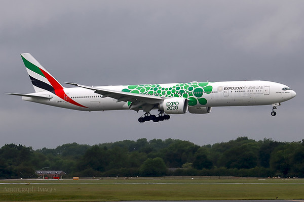 """Reg: A6-EPU Operator: Emirates Airline Type: Boeing 777-31hER  C/n: 42340 / 1441  Location: Manchester (MAN / EGCC) - UK   """"EK17"""" on very short final for 05L in rainy   summer weather, wearing the EXPO 2020 """"sustainability"""" special colours      Photo Date: 19 June 2020 Photo ID: 20...."""