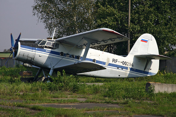 RF-00294 - Antonov An-2 (c/n 1G20629)  Parked in the grass at the re-work facility at Chernoye, outside Moscow, Russia. 08 September 2008