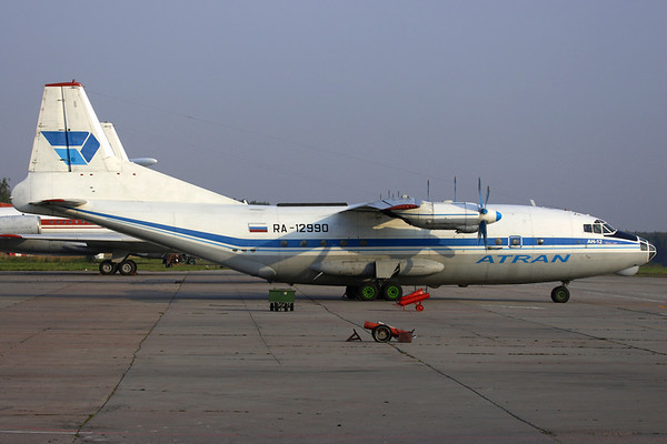 RA-12990 - Atran Airlines, Antonov An-12B (c/n 00347304)  Very tidy An-12 parked on Moscow Domodedovo's cargo ramp in early morning light. 06 September 2008