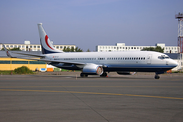 OE-ILX - Global Jets Austria, Boeing 737-8DR BBJ2 (c/n 32777 l/n 882)  The former Multiflight BBJ2 (ex G-OBBJ) parked in a taped off area on a remote ramp at Moscow-SVO. 07 September 2008