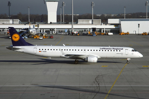 Reg: D-AEBH Operator: Lufthansa Regional Type:  Embraer ERJ-195LR C/n: 19000447   Taxiing to stand at home base of Munich, taken from the gates in Terminal 2 on a crisp winter's day.     Photo Date: 17 November 2011 Photo ID: 1200465