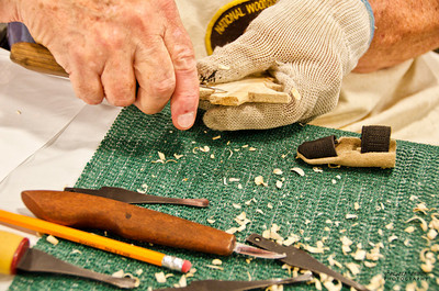 North Carolina Mountain State Fair ~ Fletcher, NC National Woodcarvers demonstrate how to carve a holiday ornament from bass wood.