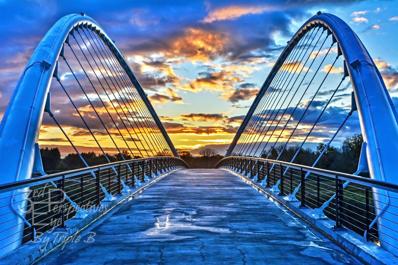 The Peter Courtney Minto Island Pedestrian Bridge in Salem, Oregon - USA.  With so much subtle and wonderful contrast, provided by this gorgeous sunset, and slightly wet conditions, I couldn't help myself cranking up the edit to high intensity and bring it all to life.