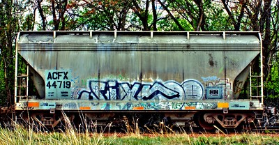 """Train Car as Art""  Saw this train adjacent to the road leading to Rocky Mountain National Park and couldn't resist the artistic nature of the picture."