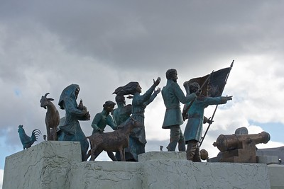 A monumental statue along the waterfront, celebrating the pioneer history of Patagonia