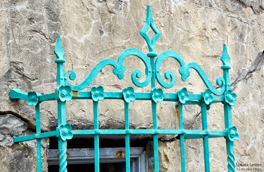 Wrought iron work on window bars.