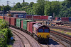 66120 passing Millbrook Freightliner Terminal with 4E68, the 15:53 Southampton West Docks - Wakefield Europort Intermodal service. 4th July 2019.
