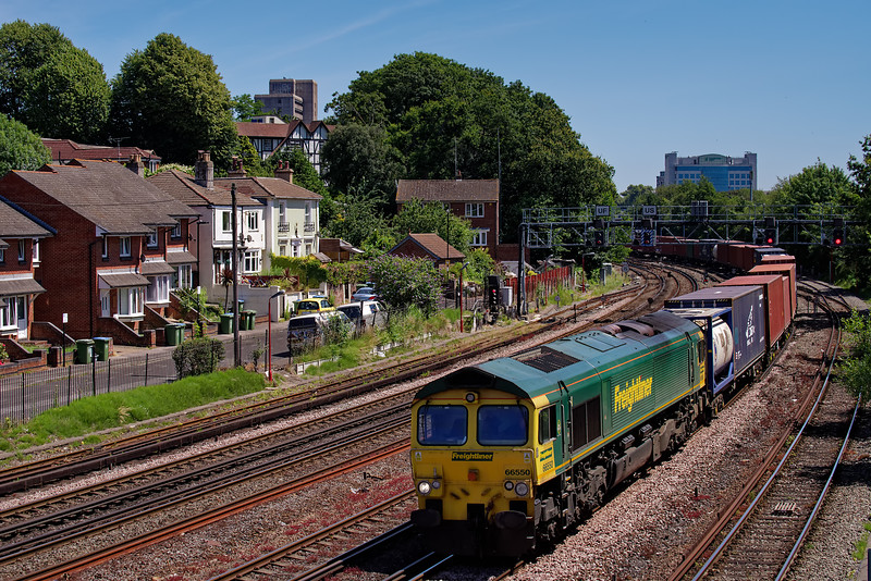 66550 rounds the curve below Southampton station with 4O14, the 05:36 Garston FLT - Sourhampton Maritime on 4th July 2019.