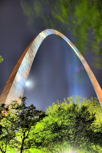 """The Gateway Arch"" Taken with a full moon just peeking from behind the bright, silver sheathing."