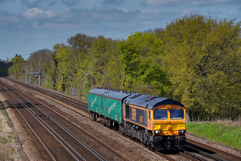 66747 working 5E08, the 09:32 Eastleigh Arlington - Peterborough, <br /> conveying Translator Vehicles on 4th May 2016.