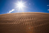 Midday sun beats down on the blowing sand in northern New Mexico.