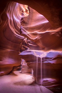 Like nature's hourglass, sands fall from the rock formations in Antelope Canyon in the slot canyons in northern Arizona
