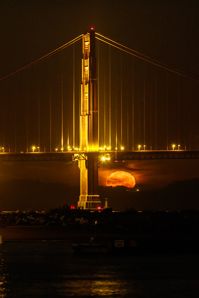 Supermoon Setting Behind the South Tower of the Golden Gate Bridge