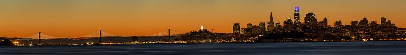Sunrise behind San Francisco and the Bay Bridge