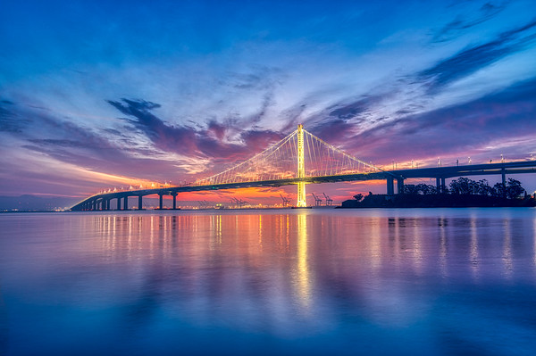 Sunrise behind the new Bay Bridge