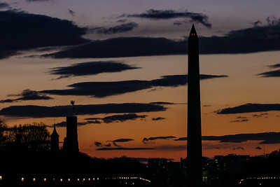 Sunset behind the Washington Monument and the Smithsonian Castle