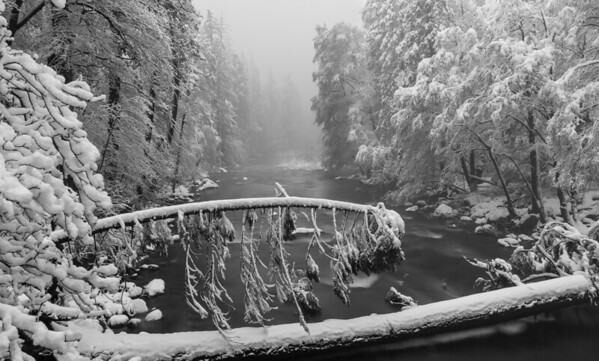 Rushing Merced River During Snow Storm