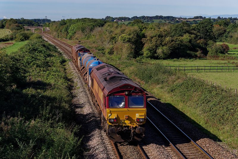 66168 top & tailed with 66160 on 3J13, the 08:50 Westbury - St Blazey RHTT, approaching Fairwood Junction. 2nd October 2019.