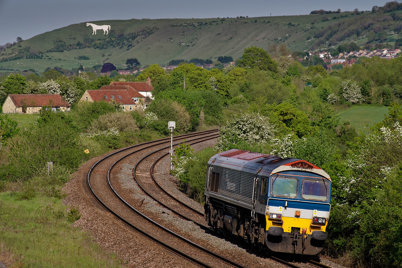 59102 comes off the Westbury avoider with 0C64, the 15:26 Acton Yard - Merehead Quarry. 13th May 2019. I wouldn't normally bother with a light engine move, but I couldn't resist this one, with the White Horse in the background.