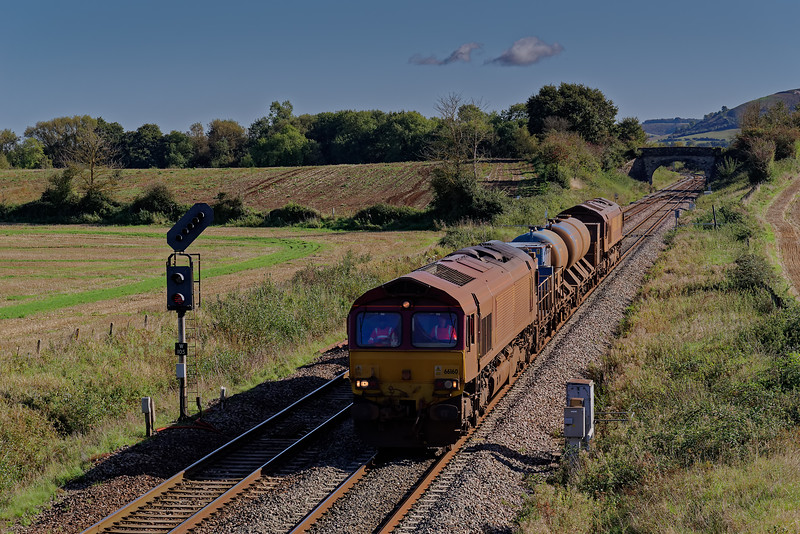 66160 top & tailed with 66168 on 3J13, the 08:50 Westbury - St Blazey RHTT, approaching Fairwood Junction. 2nd October 2019.