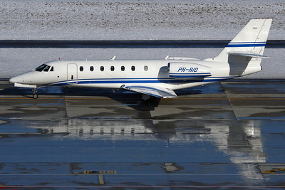 PH-RID - Cessna 680 Sovereign (c/n 680-0212)  Operated by Cartier and depicted taxiing for take off at Zurich, reflected in the pools of de-icing fluid on the stands alongside. 30 January 2010