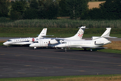 VH-MQK - Dassault Falcon 900EX (c/n 159)  Australian Falcon parked on a  remote ramp at Zurich, alongside Dornier Do328-JET HB-AEU and Citation Sovereign EC-KMK. 02 July 2011