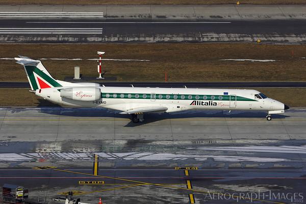 Reg:  I-EXMDOperator:  Alitalia ExpressType:   Embraer ERJ-145LR  C/n:  1454453Location:  Zurich - Kloten (ZRH / LSZH), Switzerland Taxiing to runway 28 for departure to Milan on a freezing Day in Zurich Photo Date:  28 January 2006Photo ID:  1300882