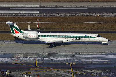 Reg:  I-EXMDOperator:  Alitalia ExpressType:   Embraer ERJ-145LR  C/n:  1454453Location:  Zurich - Kloten (ZRH / LSZH), Switzerland Taxiing to runway 28 for departure to Milan on a freezing Day in Zurich Photo Date:  28 January 2006Photo ID:  1300882