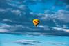 B075  Yellow balloon rising high