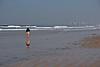 Lone beach stroller.<br /> <br /> Silver Strand State Beach, Coronado Island, CA.