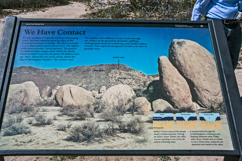 D084-2009  An Interpretive sign that discusses two of the primary rock forms found in the park, Pinto gneiss and monzogranite.<br /> Seen at a pull-out along the road across the Pinto Basin.<br /> <br /> Along the drive from the south entrance, to the north entrance in Twentynine Palms<br /> <br /> Joshua Tree National Park, California<br /> March 25, 2009