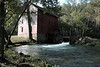 Alley Mill.  Even though the working parts of the mill lie in deep shadow in the late afternoon, the sun still lights in the most dramatic way the joyful rush of the water that exits the mill, on its way back to rejoin the rest of the spring's water on its way to the Jack's Fork River, and then on to the Current River.<br /> <br /> Alley Spring State Park, Shannon County, Missouri