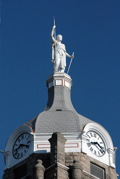 Minerva greets the morning.<br /> <br /> A statue atop the Johnson County courthouse in Warrensburg, MO.  The statue faces east.  The picture was taken in early August, 2008