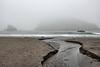 A freshwater stream cutting across the beach.<br /> <br /> Harris Beach State Park, Brookings, Oregon.