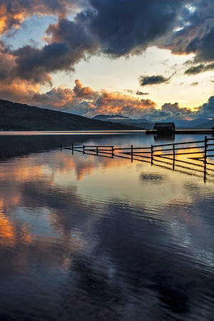 Portait version of Brenachoile Boathouse at Sunset
