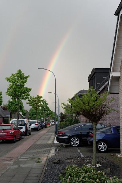 Rainbow over residential street