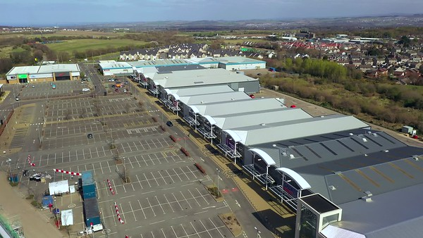 STOCK 4K AERIAL Lockdown Edinburgh Straiton Retail Park 200413 001