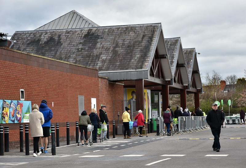 shoppers queue at Asda, Shrewsbury. 10.53am Sat 28th March.