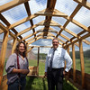 Locke Middle School industrial arts teacher Teresa Rogers, and principal Anthony Garas, with the greenhouse that students have almost finished building behind the school. (SUN/Julia Malakie)