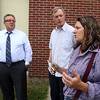 From right, Locke Middle School industrial arts teacher Teresa Rogers, selectman George Simolaris, who'd brought some seeds, and principal Anthony Garas, behind Locke Middle School. (SUN/Julia Malakie)