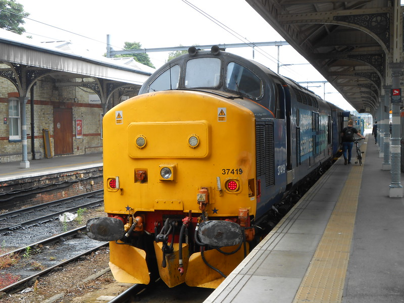 """37 419 <br /> <br /> sits at Norwich on back of the loco hauled set waiting to work to <br /> <br /> Great Yarmouth <br /> <br /> on <br /> <br /> 2P18 10.36 Norwich - Great Yarmouth <br /> <br /> This was the loco that on 7th March 2015 worked down the Preston <br /> <br /> Ormskirk line on a pathfinder tour and me and Liz went to photo it <br /> <br /> see link below <br /> <br /> <a href=""""https://theghoststationhunters.smugmug.com/Charters-Tours-I-Photograph/37419-Ormskirk-on-Lancs-Link-T/"""">https://theghoststationhunters.smugmug.com/Charters-Tours-I-Photograph/37419-Ormskirk-on-Lancs-Link-T/</a>"""