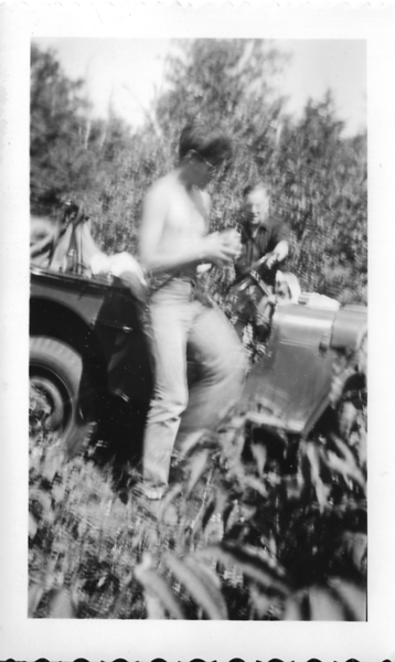 A scene of Roger Gilmore's Jeep climbing Mount Moosilauke on September 9, 1951, with Bobby Moody (left) and Smith (Mike) Johnson.