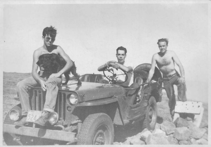 Bobby Moody (w/Cinder) of Warren NH, Roger, + Bill Hight (at rear), Ravine Camp Mgr., in Roger's Jeep on summit of Mt. Moosilauke Sunday 9-9-51.