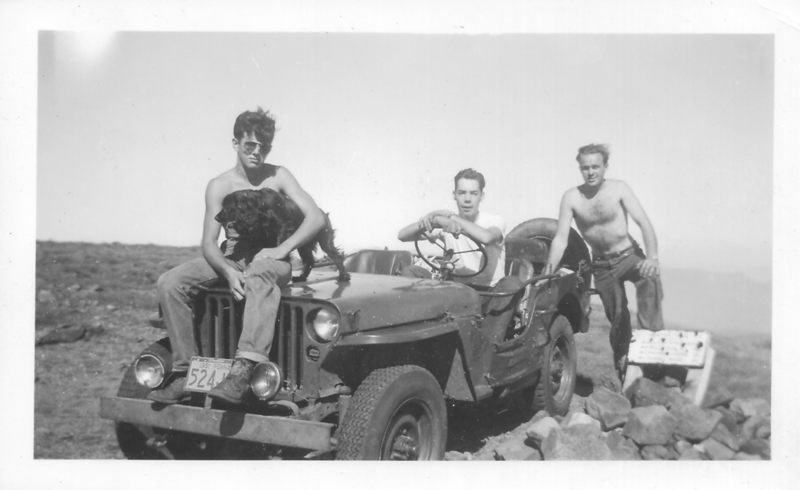 Bobby Moody (w/Cinder) of Warren NH, Roger Gilmore '54, and Bill Hight (at rear), Ravine Camp Mgr., in Roger's Jeep on summit of Mt. Moosilauke Sunday 9-9-51.