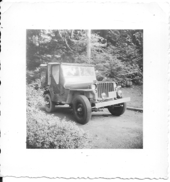 Roger's Jeep (used U.S. Navy Jeep). Purchased early Aug.'51, Traded for '37 Plymouth, Sept.51 (after piston rod broke descending Moosilauke).  Photographed in a Philadelphia driveway.