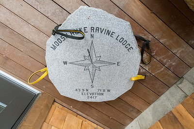 A stone - to be placed in the ground out front? of Moosilauke Ravine Lodge. Photo by David Kotz '86.