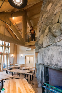 The new Ravine Lodge includes a larger main room, with a small balcony (above) as Viva Hardigg demonstrates. Photo by David Kotz '86.