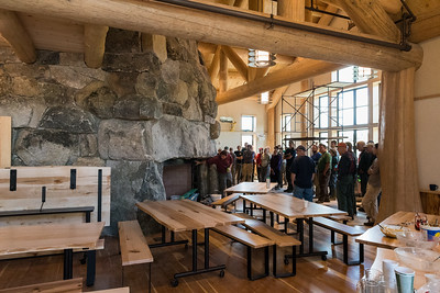 The work crew watches as Project manager James Pike explains the new Ravine Lodge. Photo by David Kotz '86.